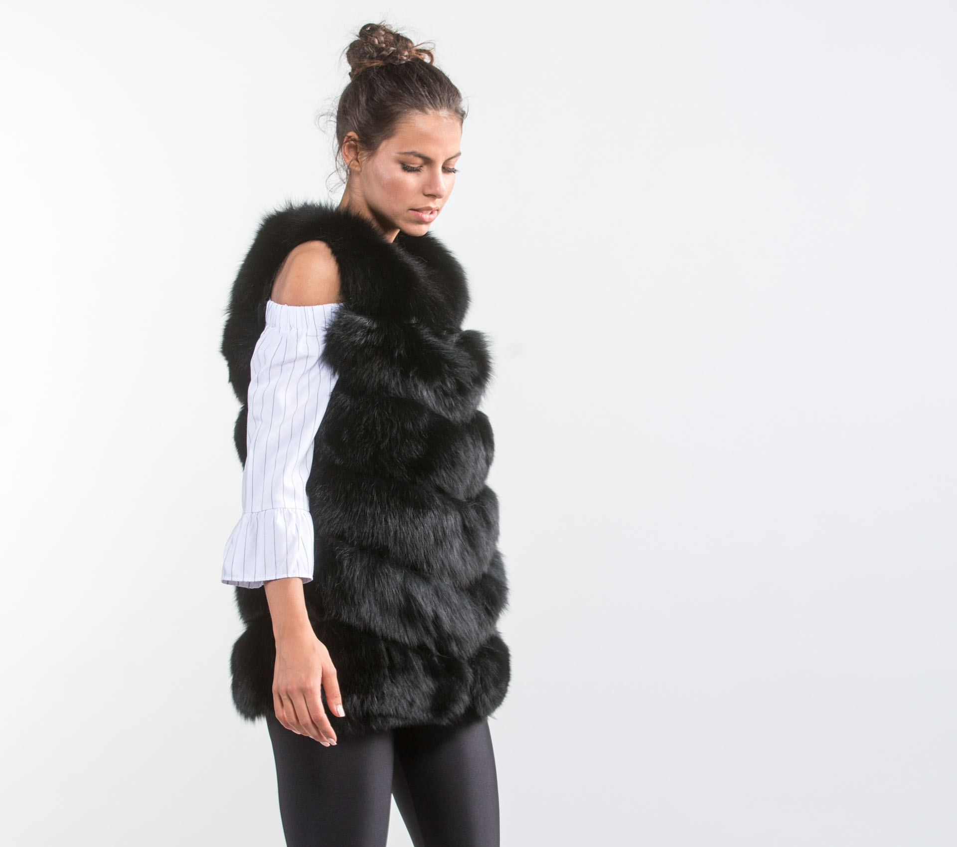 Make a chic and cozy statement in this soft, plush vest with ombré shading and faux fur trim. Individual style. Clean, modern lines. The exclusive Black Label by Chico's ™ collection. 85% acrylic, 15% polyester. Imported.