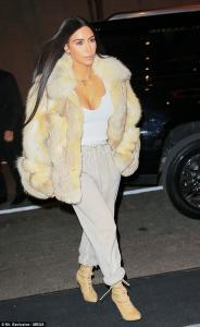 8bbc04c40b6b Kim Kardashian puts everything on display in a sheer top her black and  white fur coat.