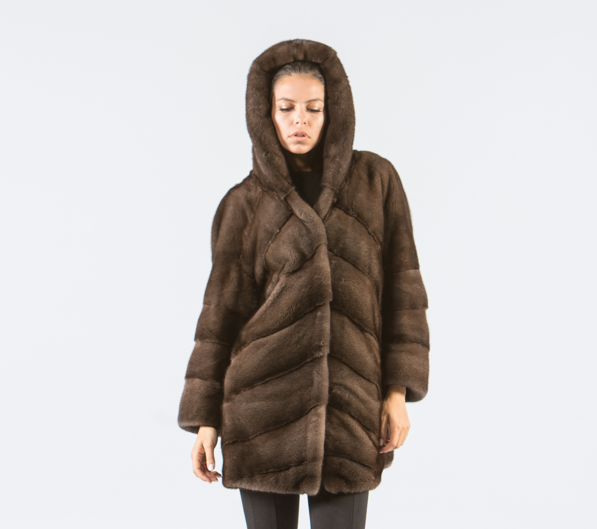 Color is brown. Front of coat has 2 small snap breast pockets, 2 large snap pockets at the bottom and 2 vertical zip pockets between the snap pockets. Includes removable zip on fur collar and permanent hood.