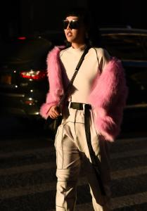 Michelle Song is seen wearing a pink fur jacket and Nike shirt outside the Tanaka show during New York Fashion Week Mens FallWinter 2019 on February 04 2019 in New York City